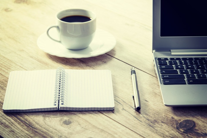 coffee cup and computer on desk.jpg