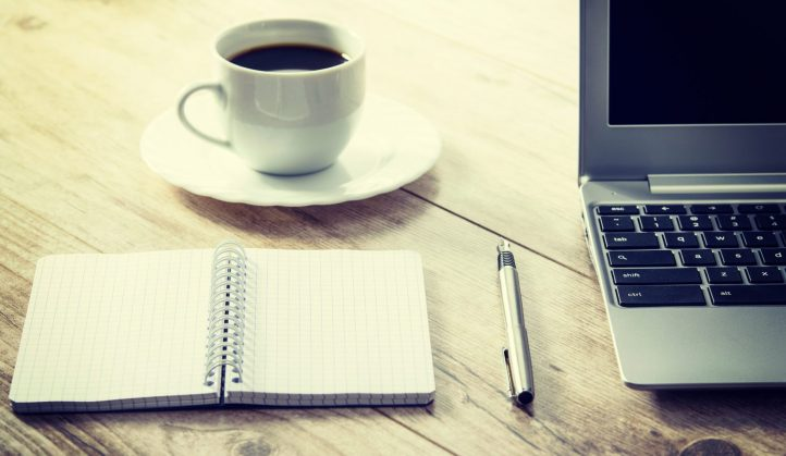 cropped-coffee-cup-and-computer-on-desk.jpg
