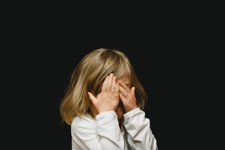 little-girl-hiding-face