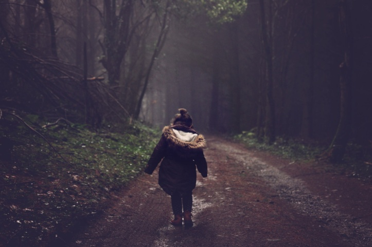 little-girl-on-a-dark-forest-road